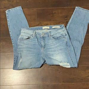 Guess Sexy Curve Distressed Skinny Jeans.